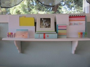 picture of shelf in Gwen Hayes office with Erin Condren planner
